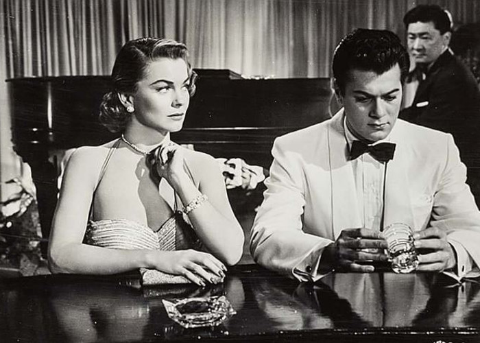 Tony Curtis, Joanne Dru, and Victor Sen Yung in Forbidden