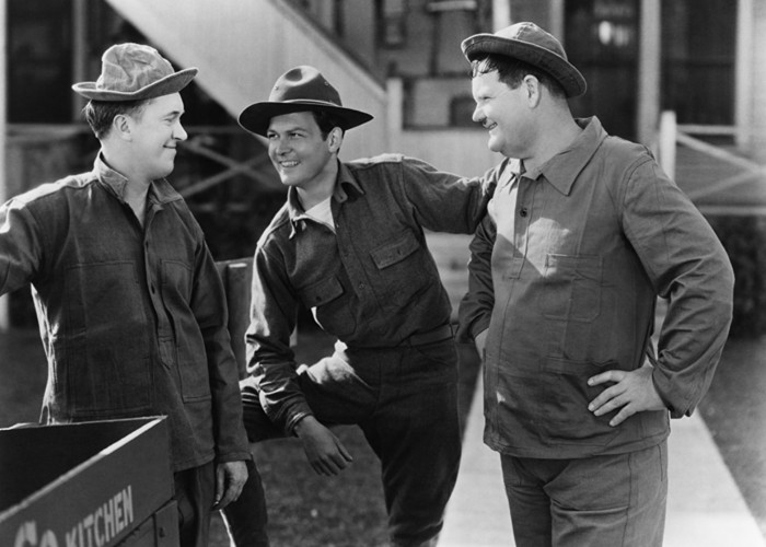 Oliver Hardy, Don Dillaway, and Stan Laurel in Pack Up Your Troubles (1932)