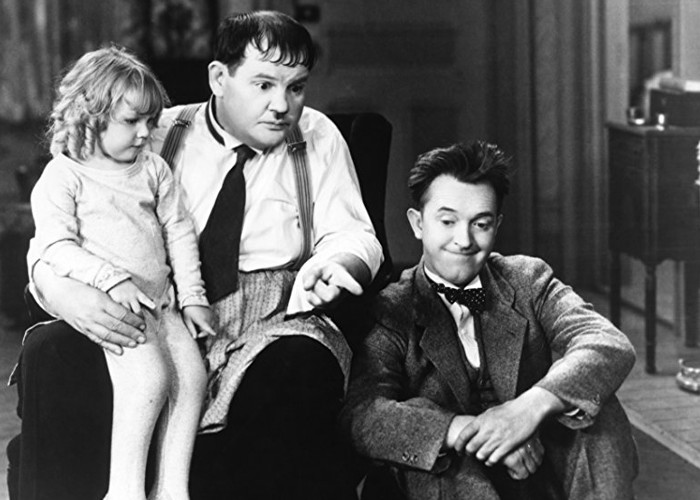 Oliver Hardy, Stan Laurel, and Jackie Lyn Dufton in Pack Up Your Troubles (1932)