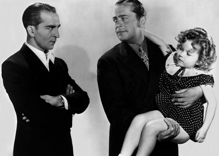Shirley Temple, James Dunn, and Ralf Harolde in Baby, Take a Bow (1934)