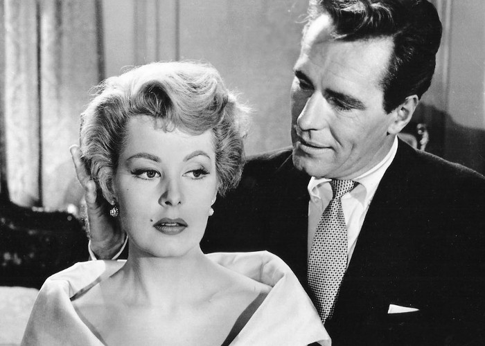 Arlene Dahl and Philip Carey in Wicked as They Come (1956)
