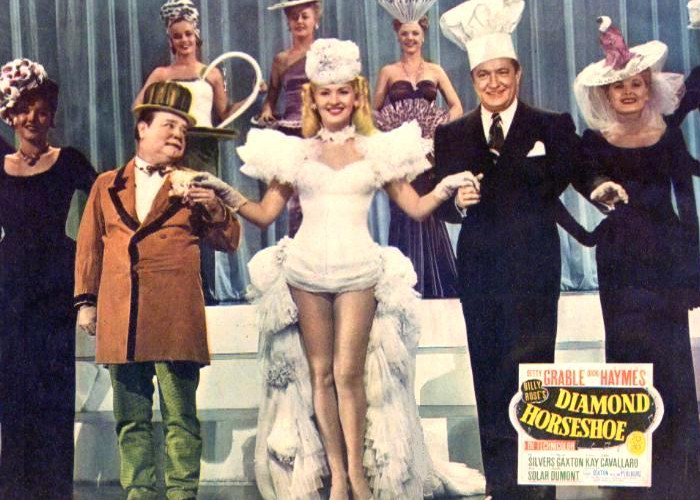 Betty Grable, William Gaxton, Beatrice Kay, and Willie Solar in Diamond Horseshoe (1945)