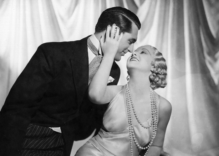 Cary Grant and Genevieve Tobin in Kiss and Make-Up (1934)