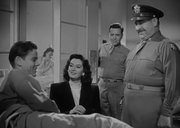 Lee Bowman, Adele Jergens, Rosalind Russell, and Charles Winninger in She Wouldn't Say Yes (1945)