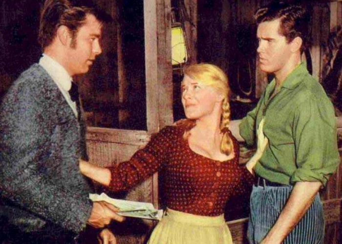 Jeffrey Hunter, Robert Wagner, and Hope Lange in The True Story of Jesse James (1957)
