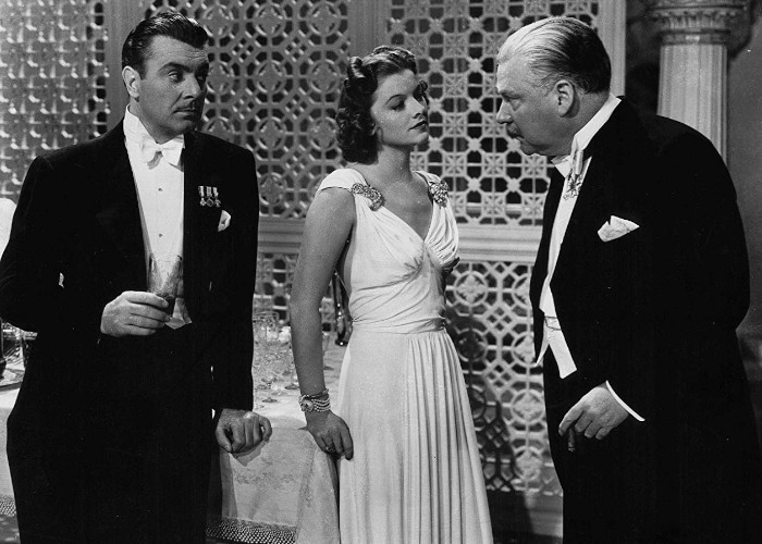 Myrna Loy, George Brent, and Nigel Bruce in The Rains Came (1939)