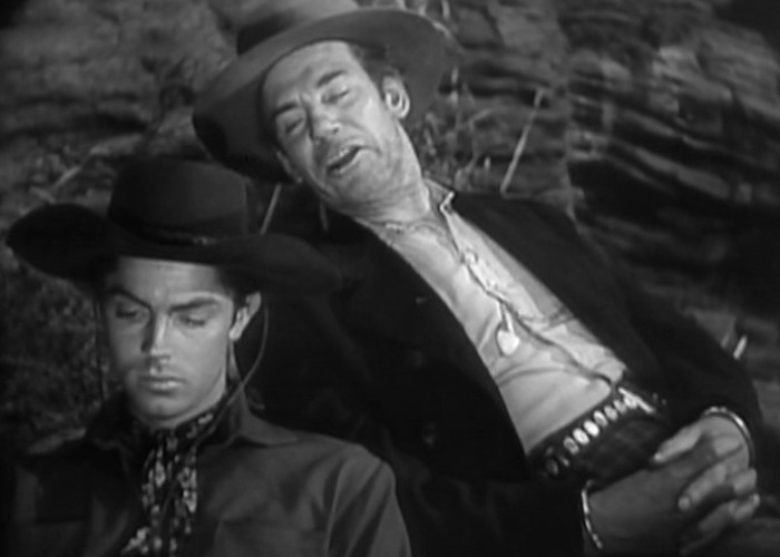 Jack Buetel and Walter Huston in The Outlaw (1943)