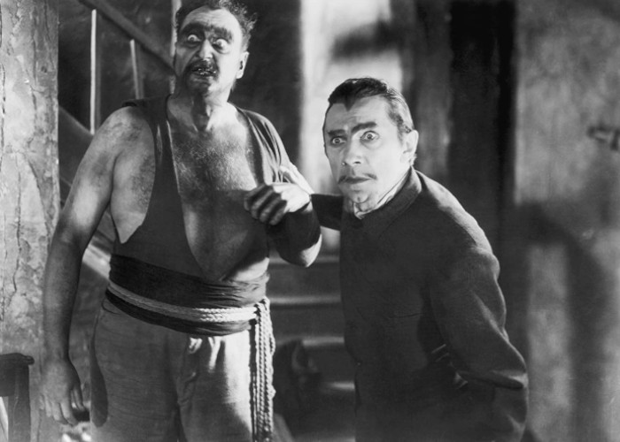Bela Lugosi and Frederick Peters in White Zombie (1932)