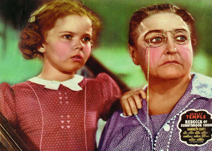 Shirley Temple and Helen Westley in Rebecca of Sunnybrook Farm (1938)