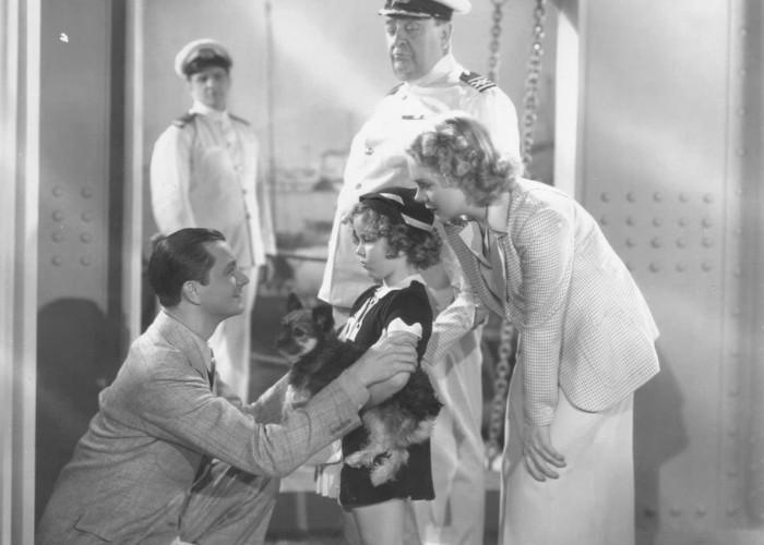 Shirley Temple, Robert Young, Alice Faye, and Robert Greig in Stowaway (1936)