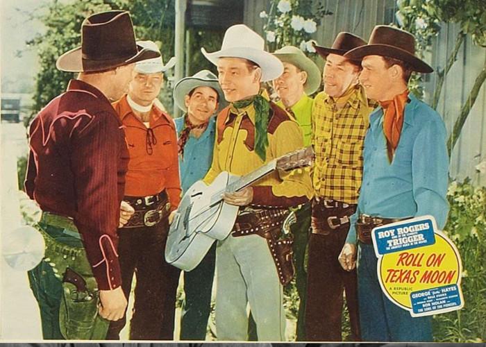 Roy Rogers, Pat Brady, Hugh Farr, Karl Farr, Shug Fisher, Bob Nolan, Lloyd Perryman, and Sons of the Pioneers in Roll on Texas Moon (1946)