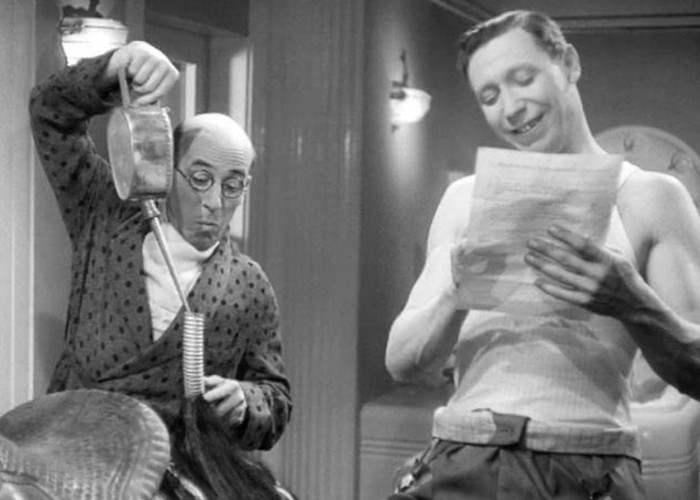 George Formby and Robertson Hare in He Snoops to Conquer (1945)